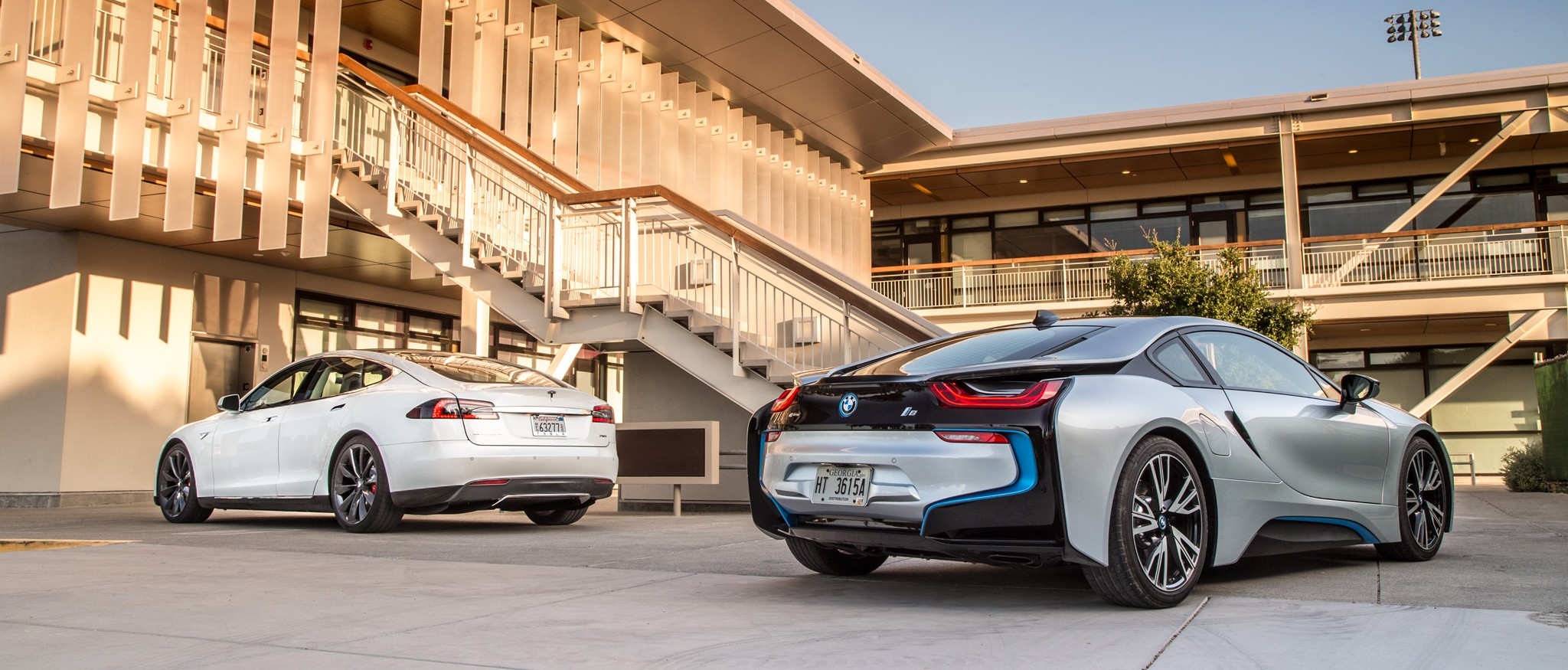 2014-bmw-i8-tesla-model-s-rear-three-quarters