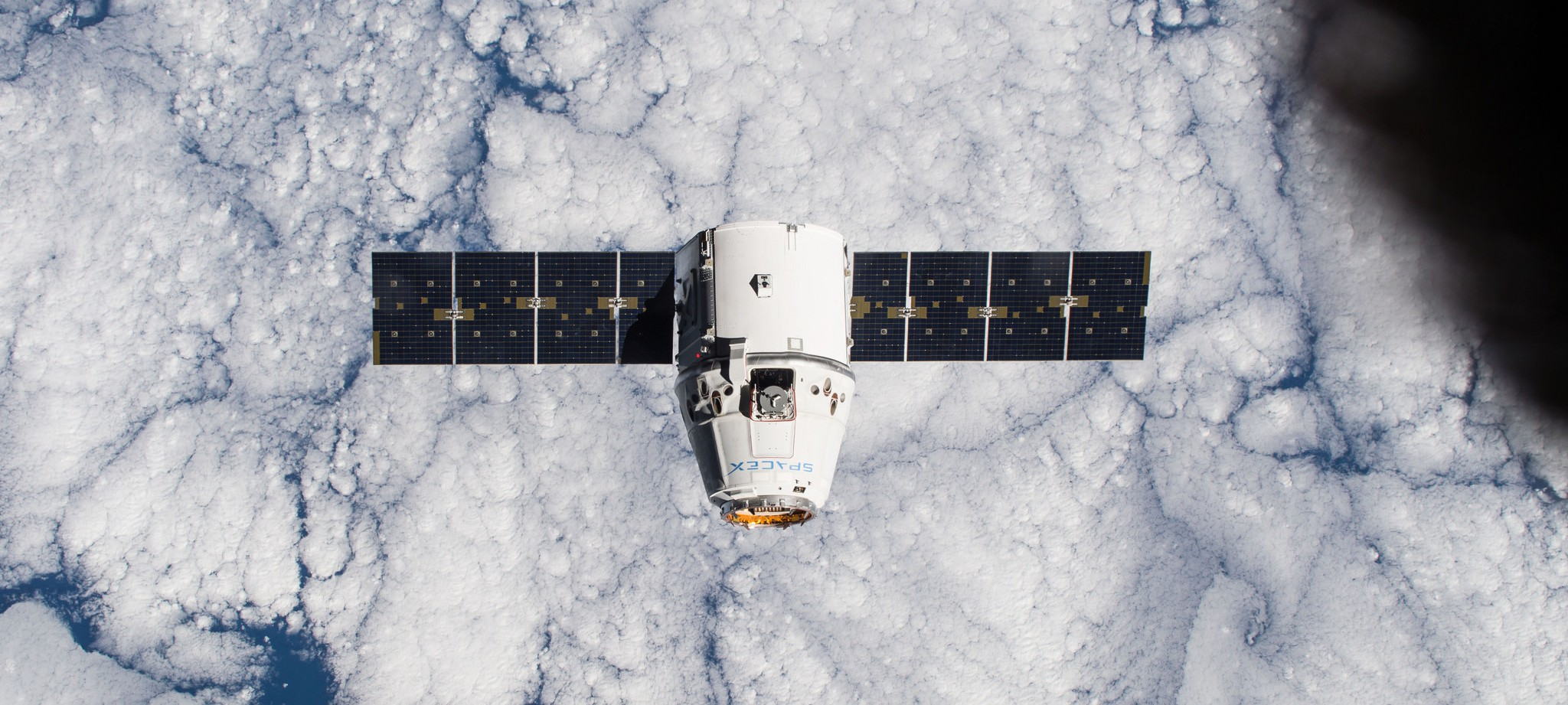 by one of the Expedition 42 crew members aboard the International Space Station, shows the SpaceX Dragon cargo craft approaching on Jan. 12 2015 - NASA Johnson