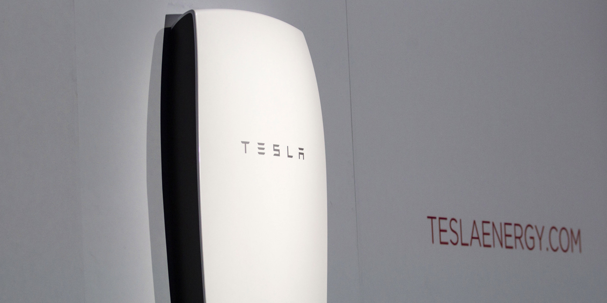 "Tesla's newest product ""Powerwall"" is unveiled on stage in Hawthorne, Calif., Thursday, April 30, 2015. Tesla CEO Elon Musk is trying to steer his electric car company's battery technology into homes and businesses as part of an elaborate plan to reshape the power grid with millions of small power plants made of solar panels on roofs and batteries in garages. (AP Photo/Ringo H.W. Chiu)"