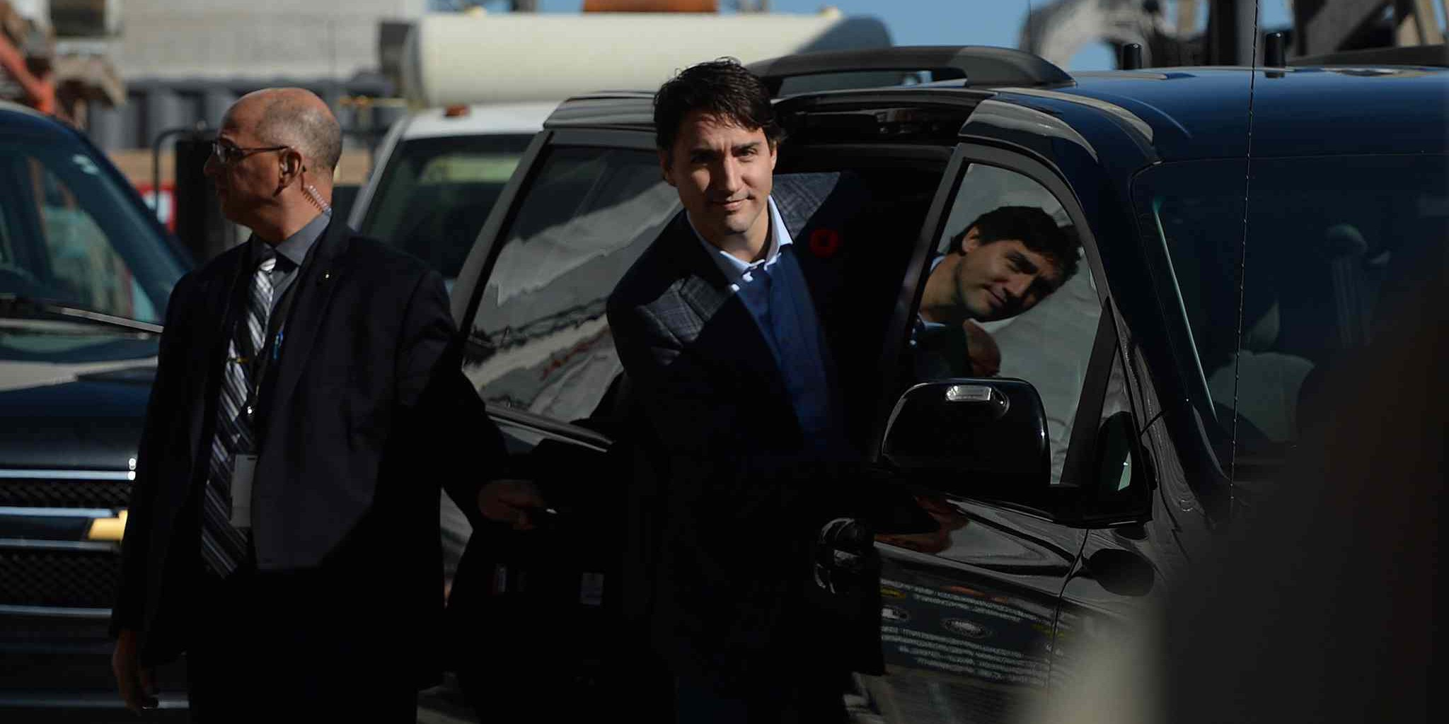 Prime minister-designate Justin Trudeau enters his car after taking a tour of the West Block construction site on Parliament Hill in Ottawa on Tuesday, November 3, 2015. THE CANADIAN PRESS/Sean Kilpatrick