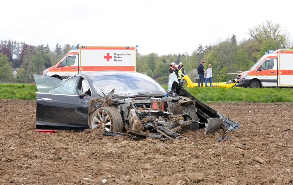 Spectacular Tesla Model S crash after flying 82+ft in the air shows