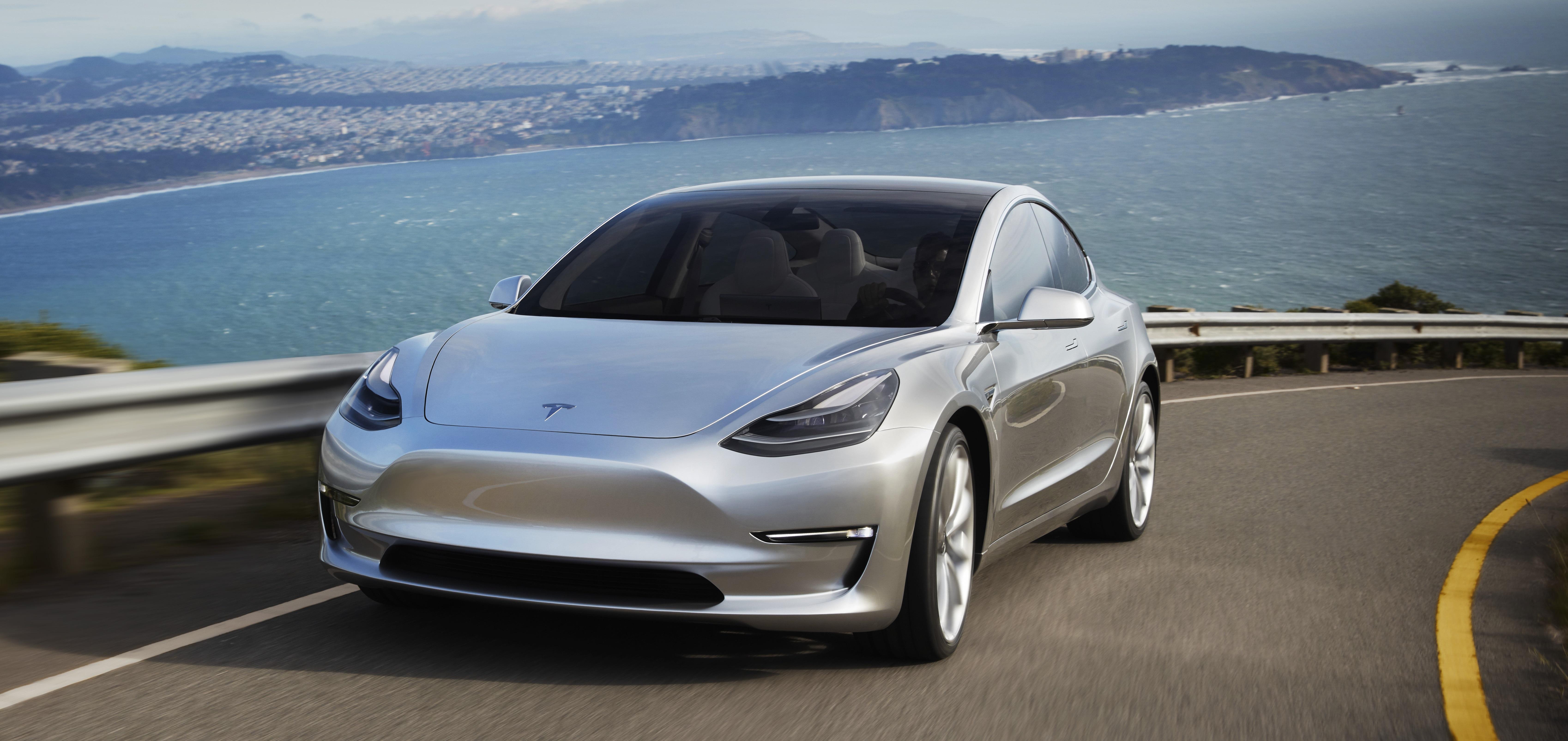 Tesla Model 3 silver prototype promo shot headlands