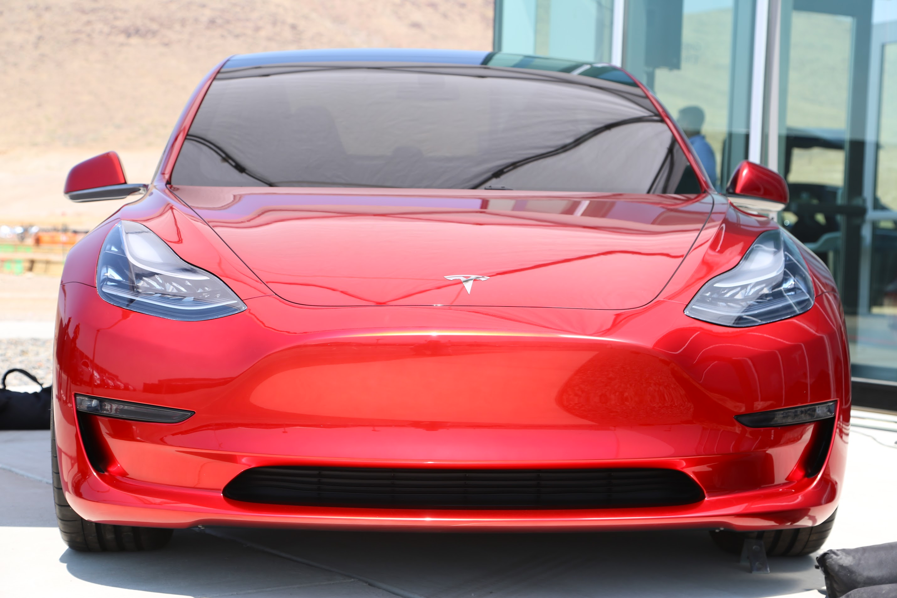 Tesla Model 3 Rare Red Prototype Displayed At The Gigafactory Gallery Car And Driver