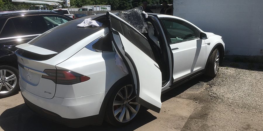 Tesla Model X Clipped One Of Its Falcon Wings On A Garage Door Gallery Electrek