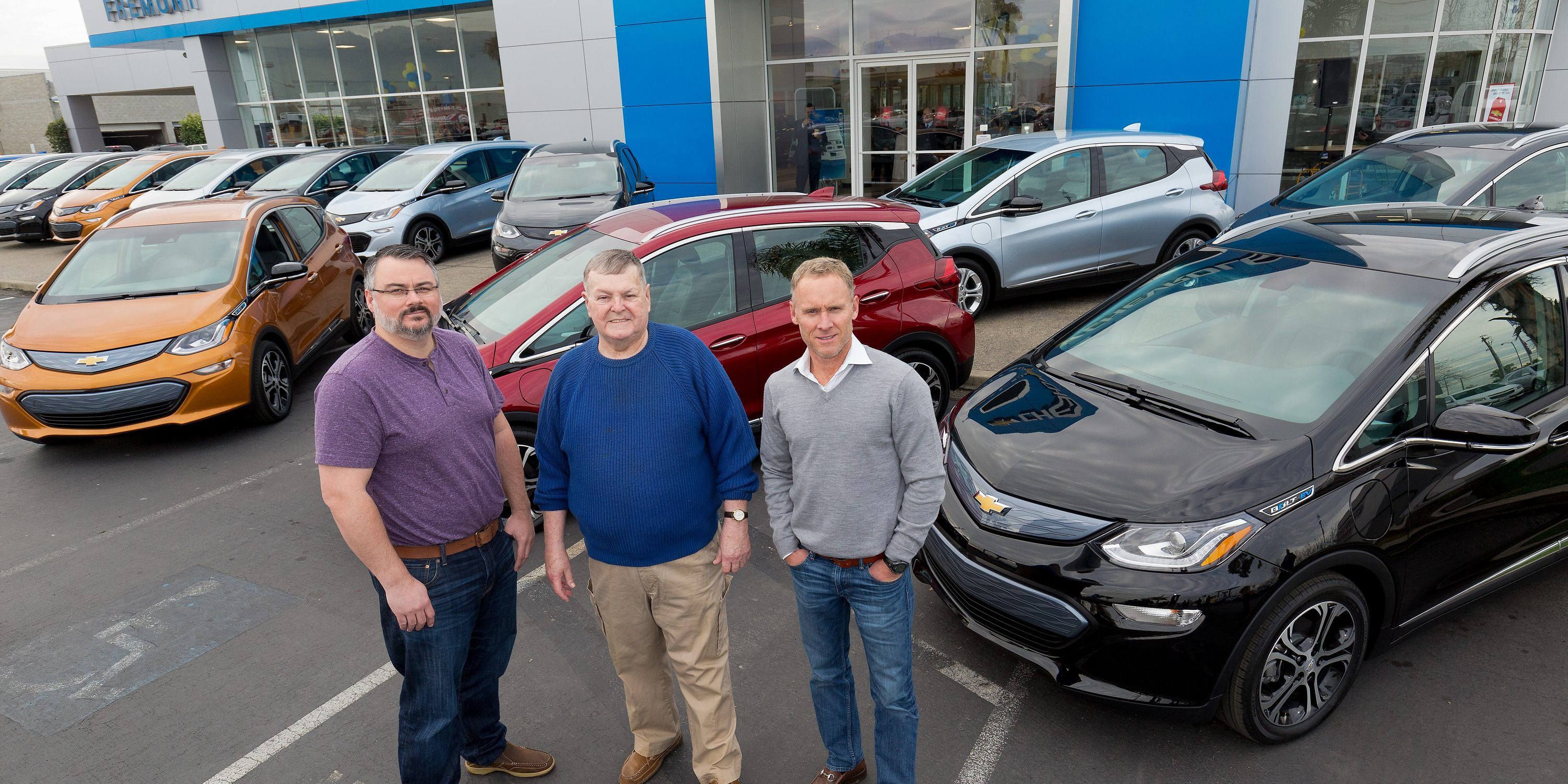 "Customers Bobby Edmonds (l) of Castro Valley, CA, William ""Bill"" Mattos of Fremont, CA, and Steve Henry of Portola Valley, CA take delivery of the first three 2017 Chevrolet Bolt EVs Tuesday, December 13, 2016 at Fremont Chevrolet in Fremont, CA. The all-electric Bolt EV offers an EPA-estimated 238 miles of range on a full charge. (Photo by Martin Klimek for Chevrolet)"