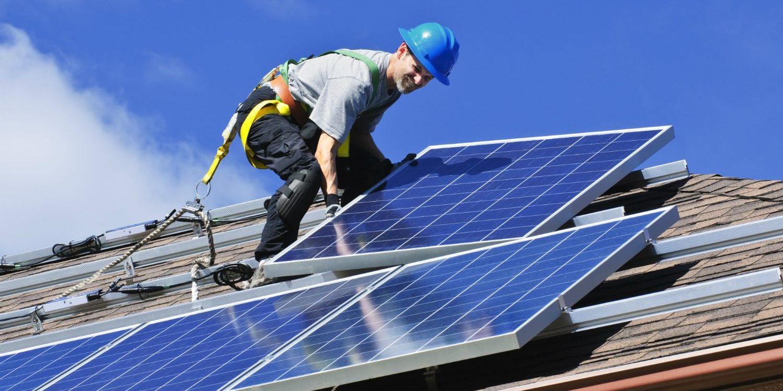 man-installing-solar-panels-on-roof