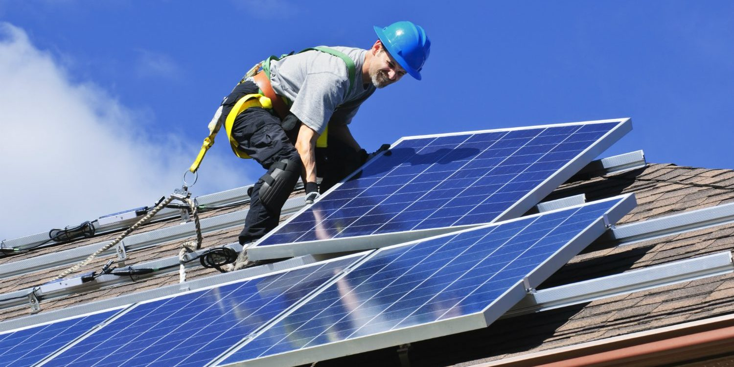 man-installing-solar-panels-on-roof