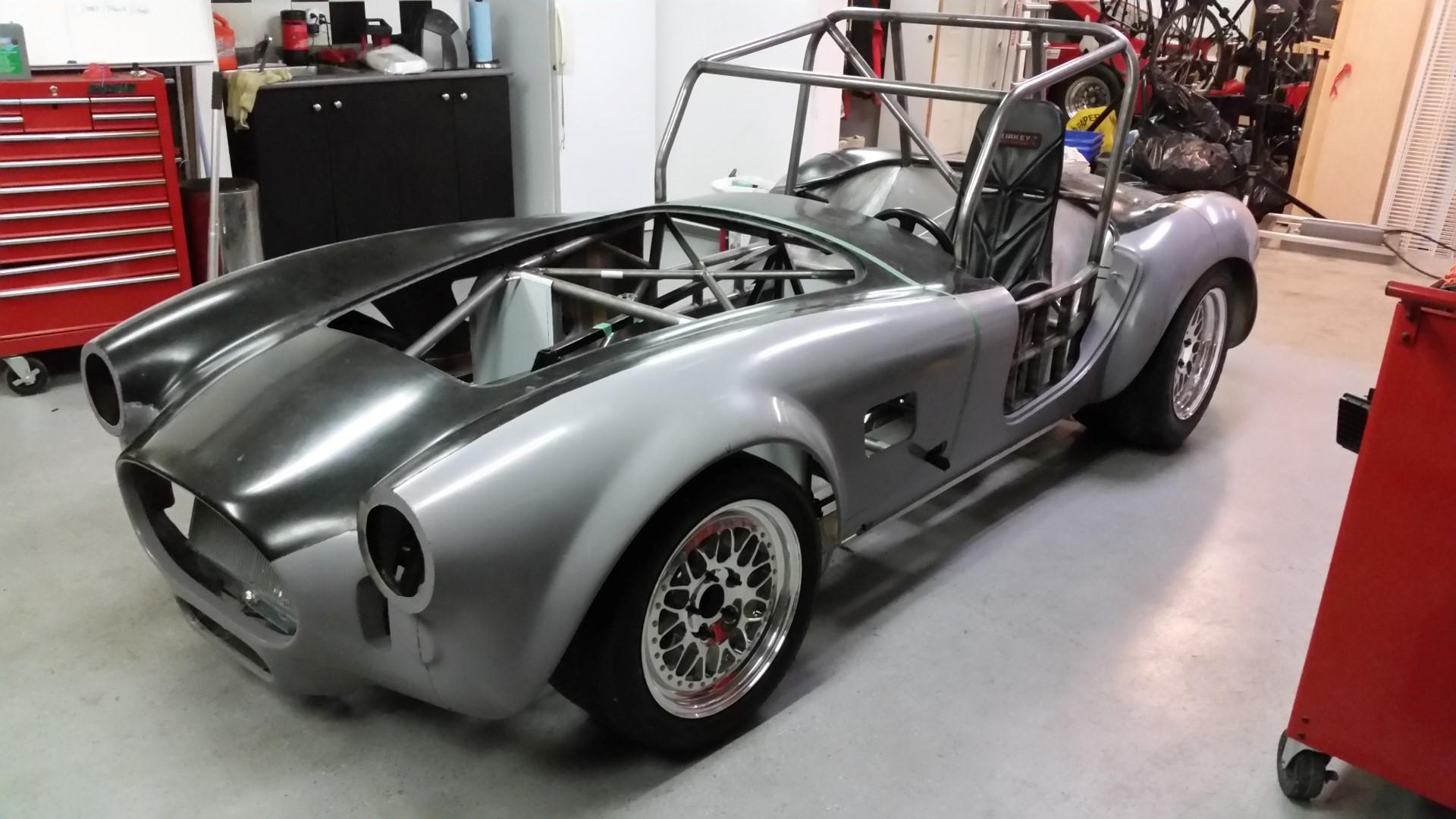 A classic 427 Shelby Cobra powered by a Tesla electric motor & Kia