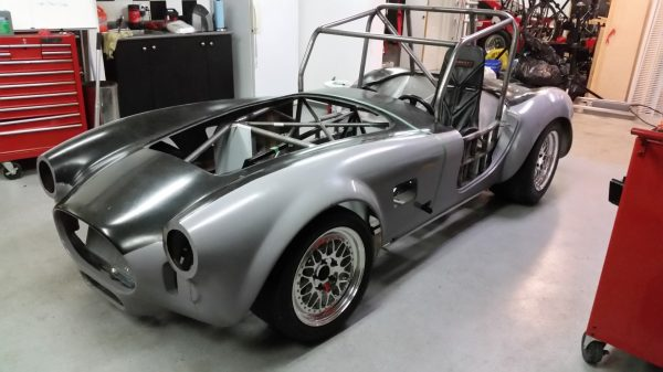 A classic 427 Shelby Cobra powered by a Tesla electric motor
