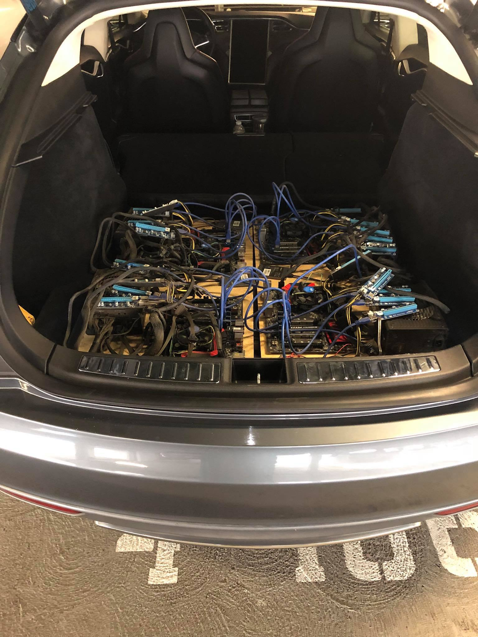 Tesla owner builds a bitcoin mining rig in a Model S to use free