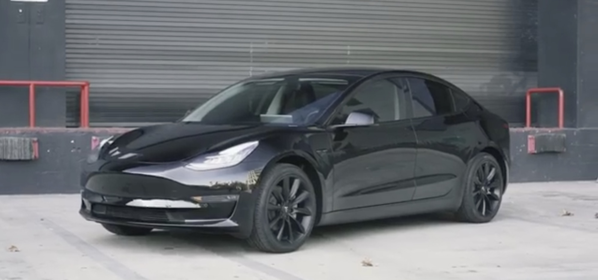 Tesla Model 3 looks badass with aftermarket chrome delete, tint and wheels