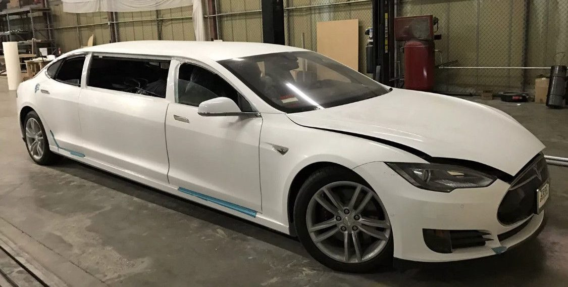 a tesla model s stretch limousine goes up for auction [update: might be a  scam]