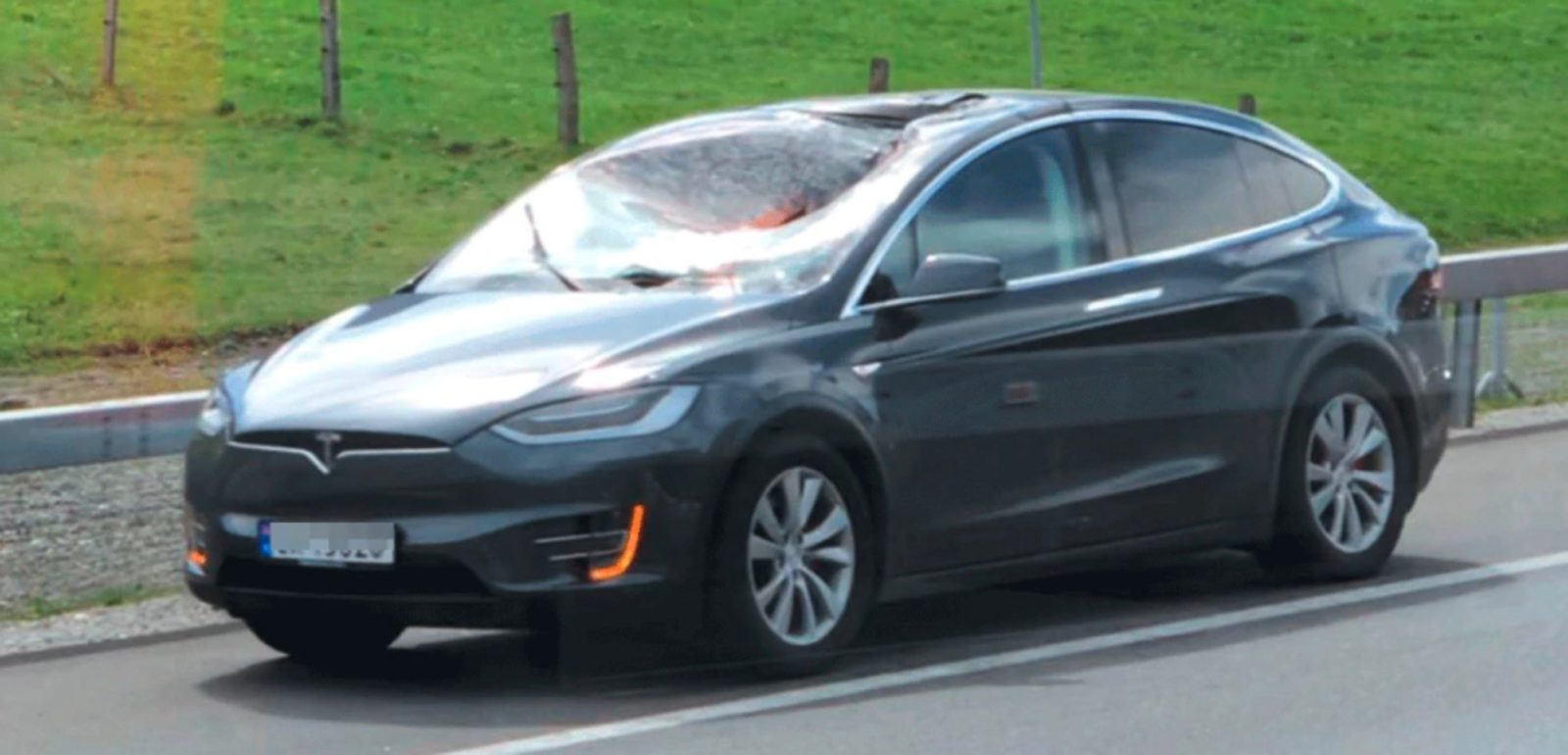 Tesla Model X windshield gets hit by a full truck wheel ...