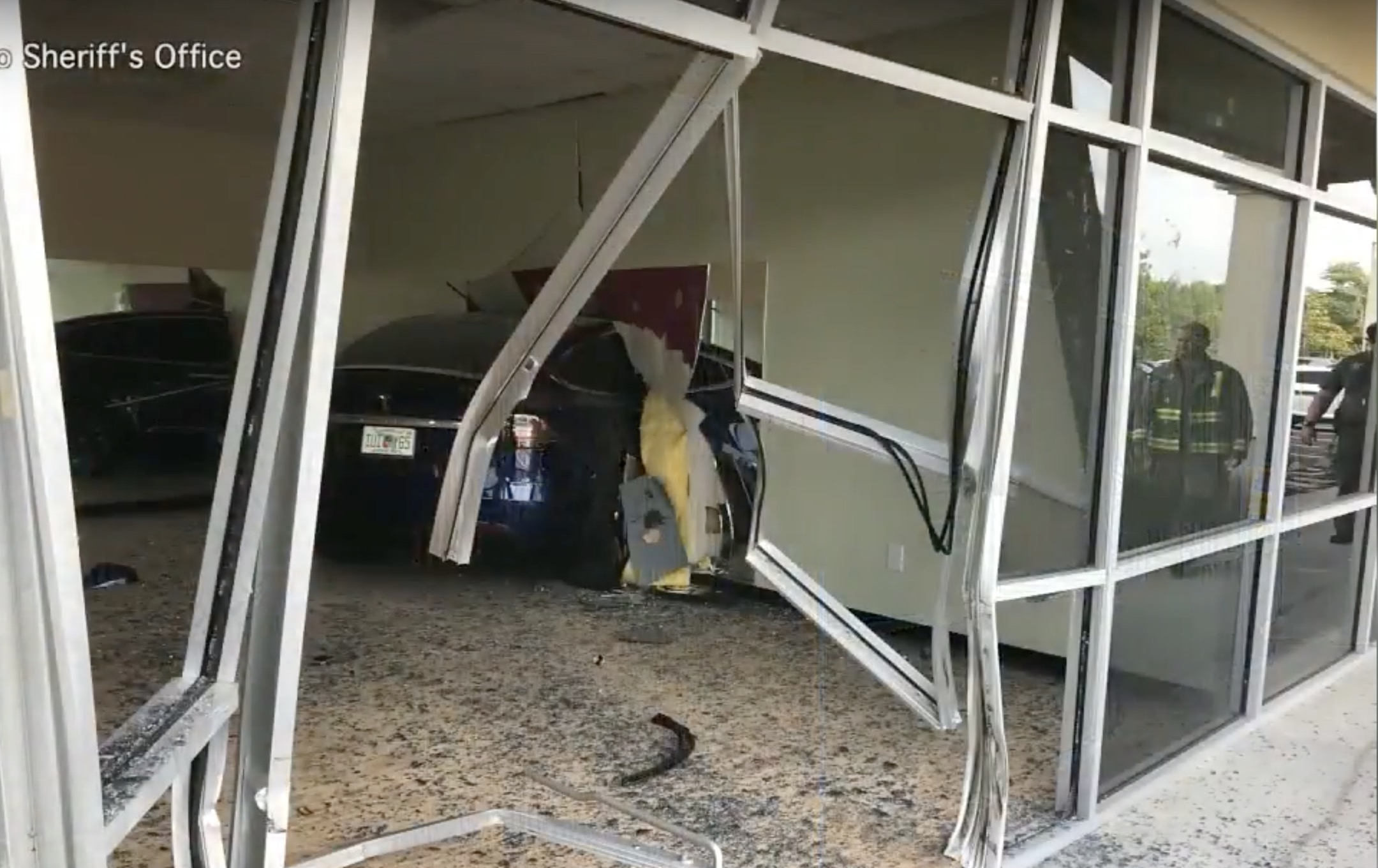Tesla Model X crashes through two walls and ends up in a gym