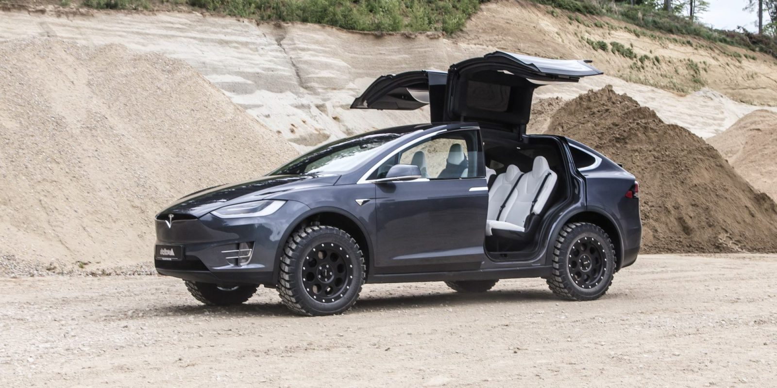 Off Road Tires For Trucks >> Tesla Model X Gets Off Road Treatment With Giant Mud Tires