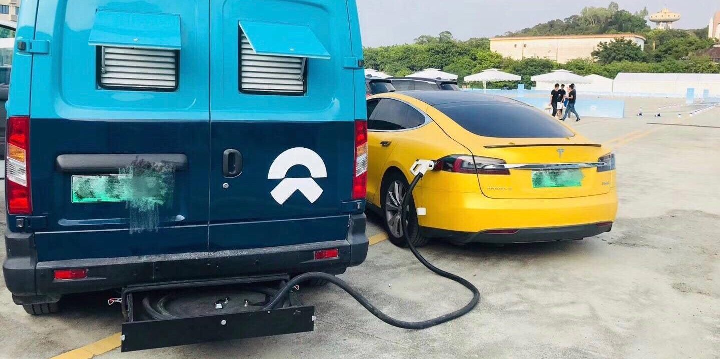NIO is courting Tesla owners with mobile charging stations inside electric vans