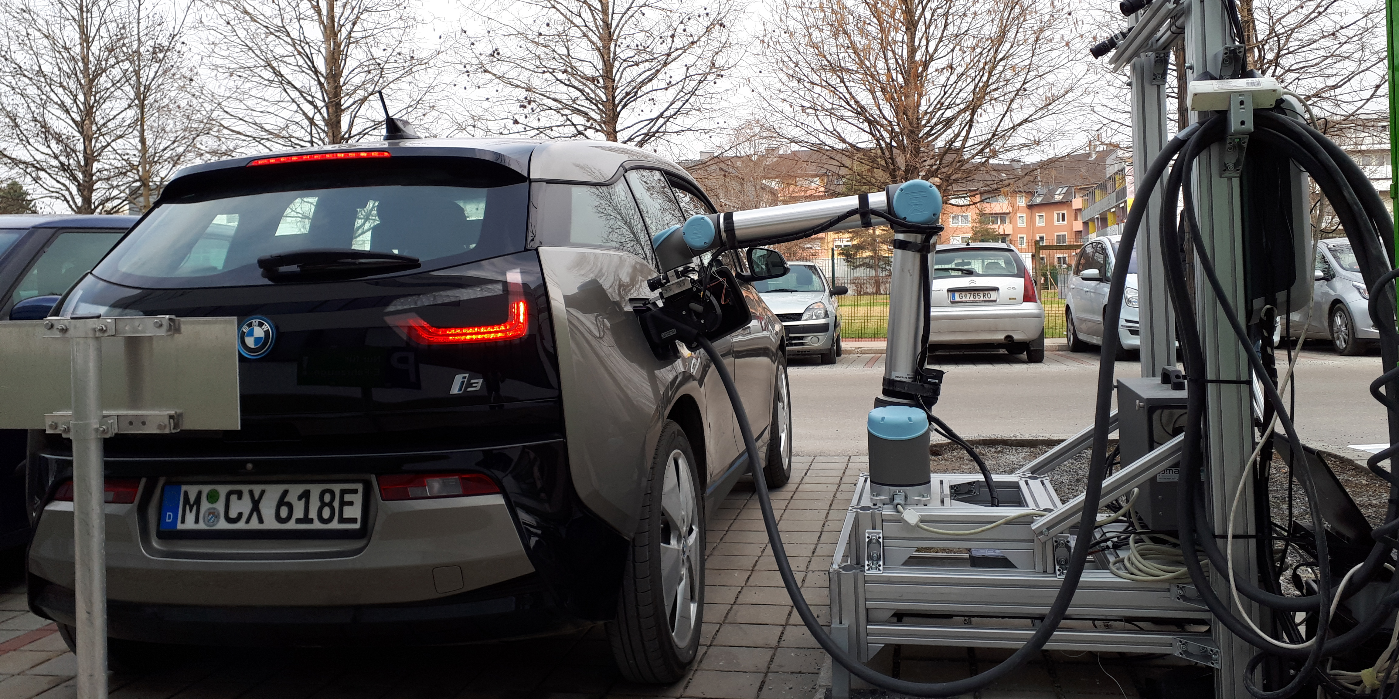 Here's a real robot electric car fast-charging station like the one Tesla has been promising for years