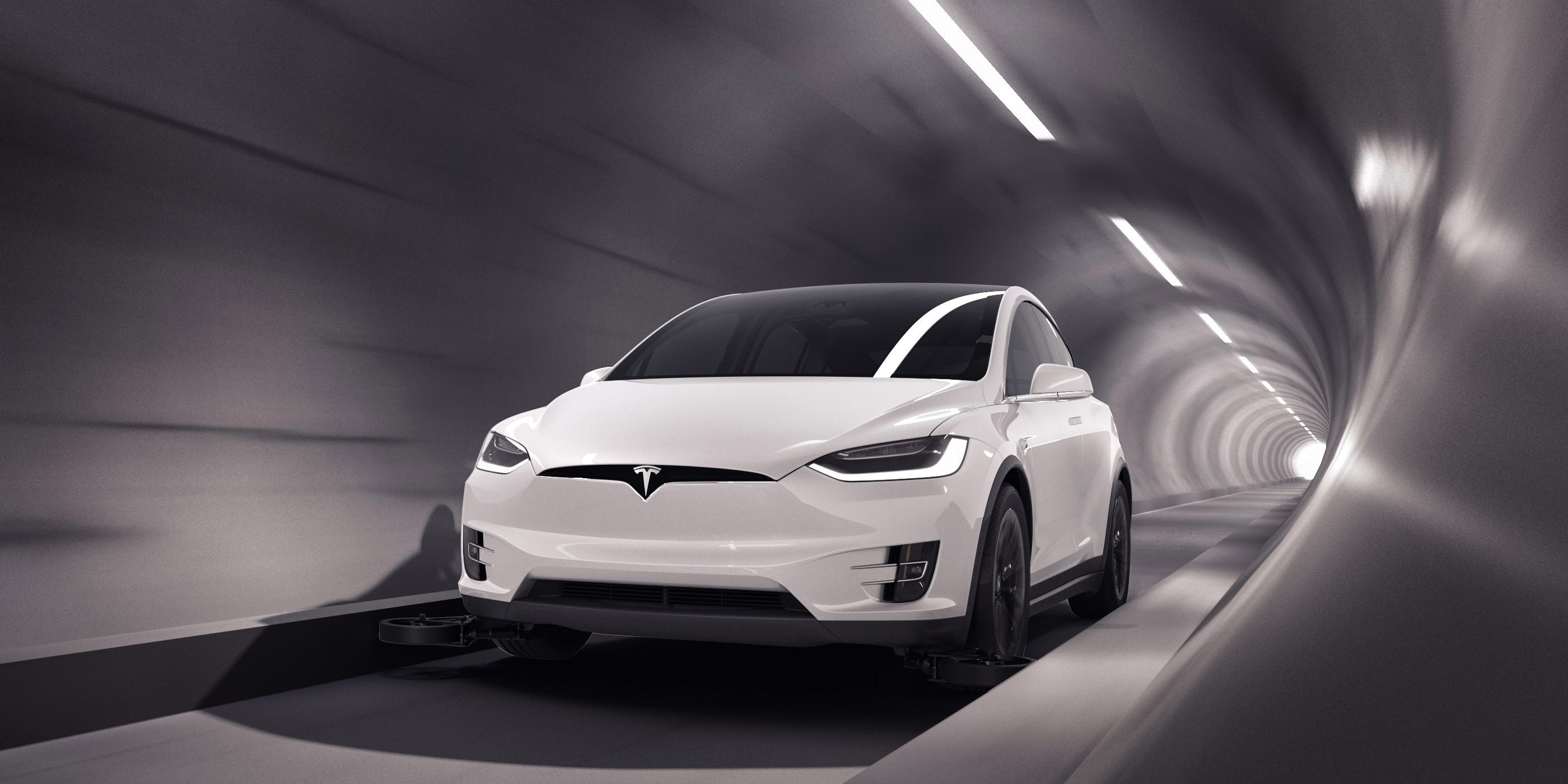 Elon Musk's Boring Company unveils first tunnel with Tesla vehicles on 'tracking wheels'