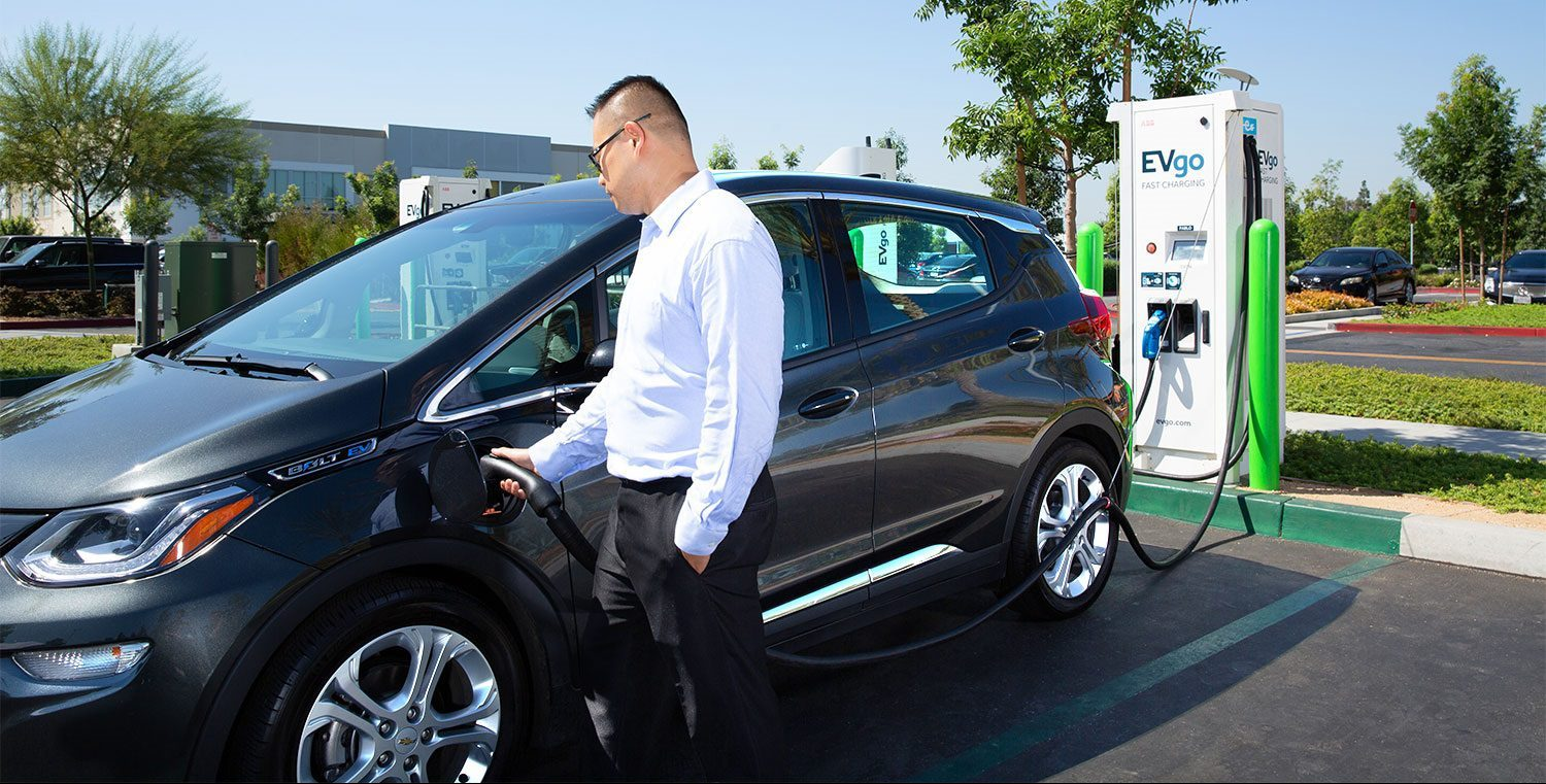 photo of GM partners with EVgo, ChargePoint and Greenlots to improve its EV charging solution image