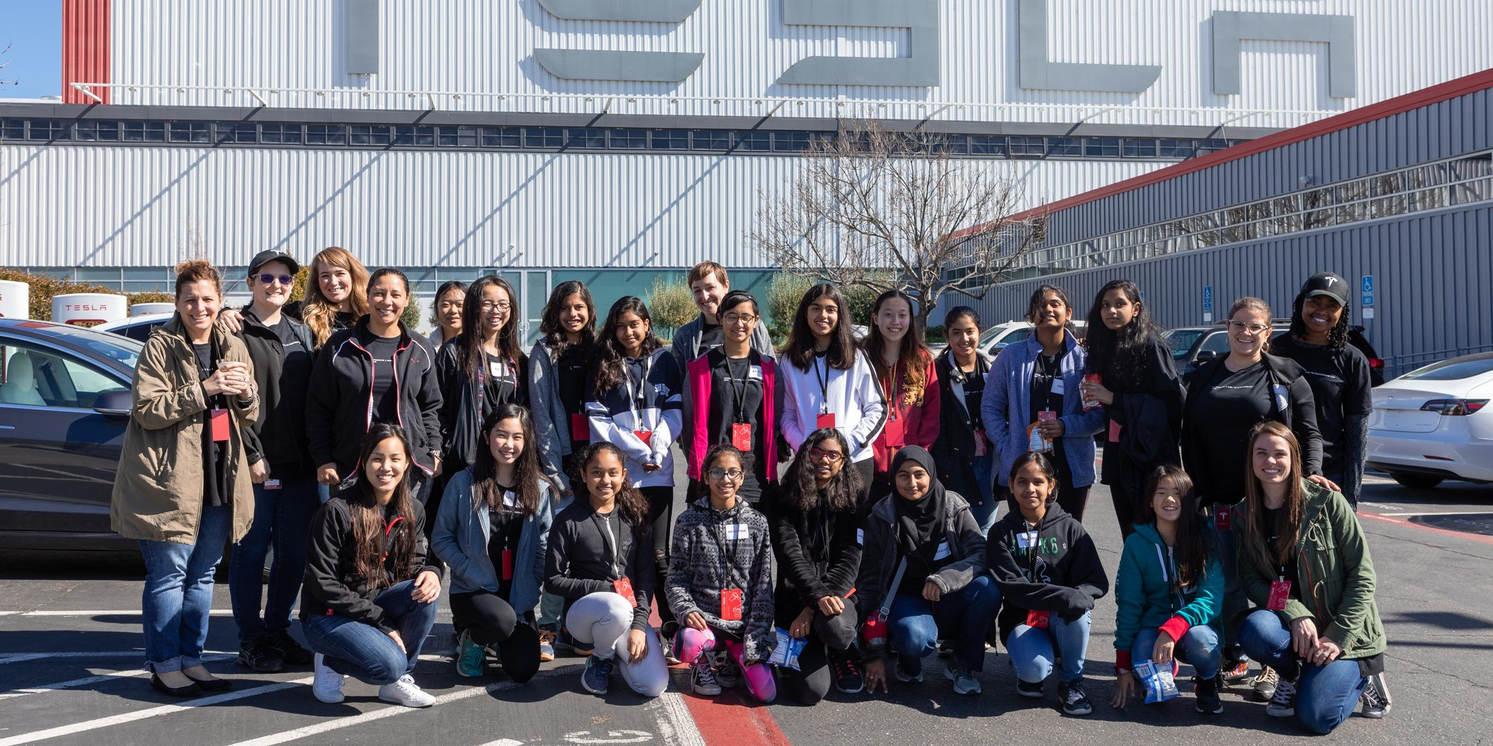 Tesla hosts hundreds of students for 'Introduce a Girl to Engineering Day' at 8 facilities