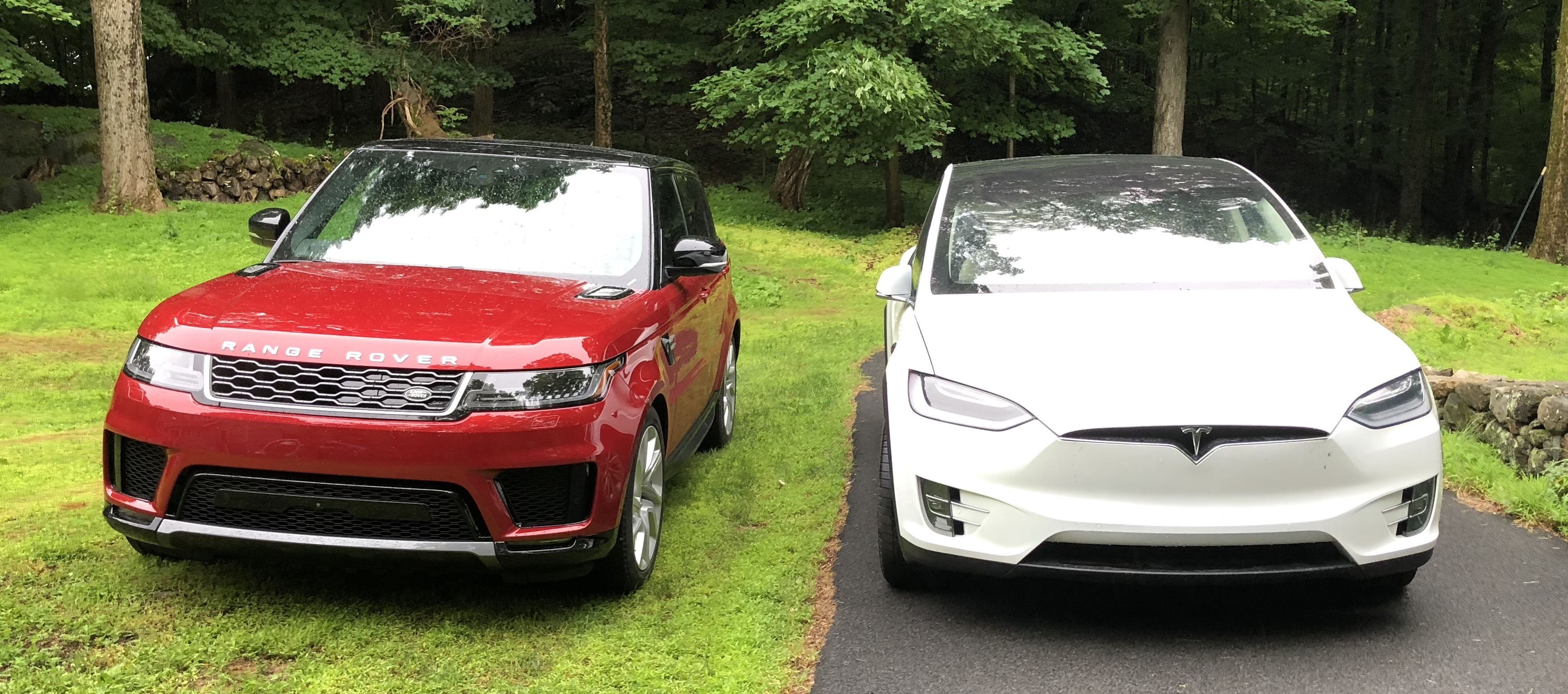 Range Rover Sport PHEV next to Tesla Model X