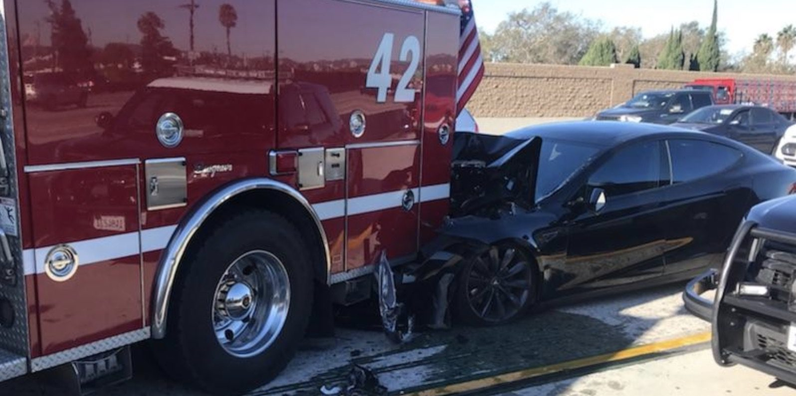 Tesla driver was eating and drinking during publicized Autopilot crash, NTSB reports