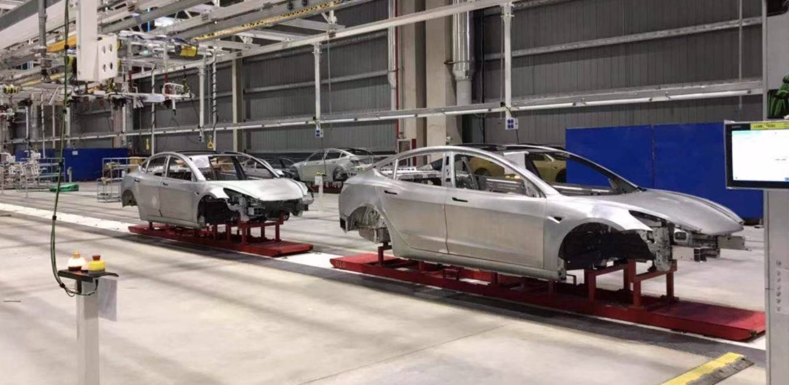 Tesla Gigafactory 3 leaked pictures show Model 3 bodies going down the line