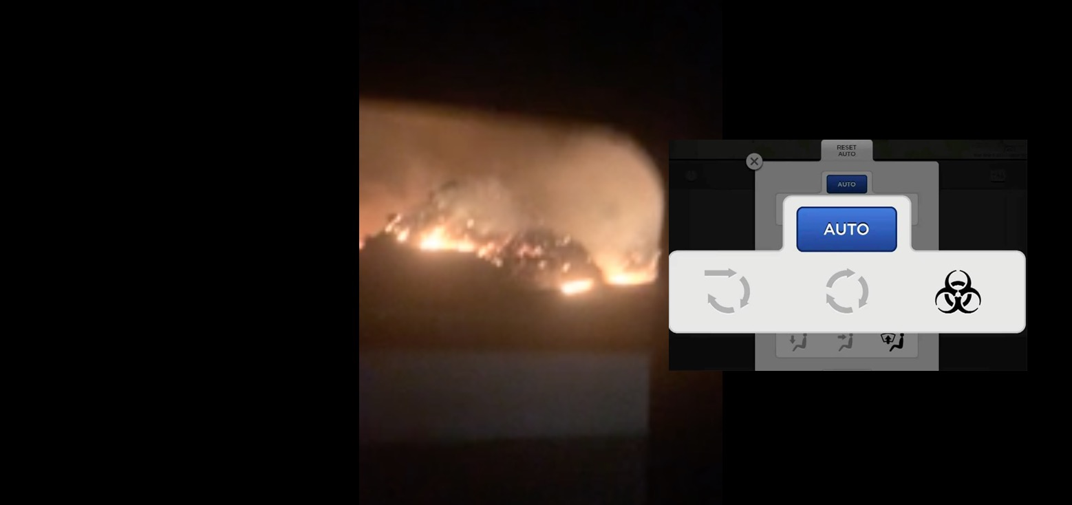 Watch Tesla with 'Bioweapon Defense' air system drive through scary wildfires
