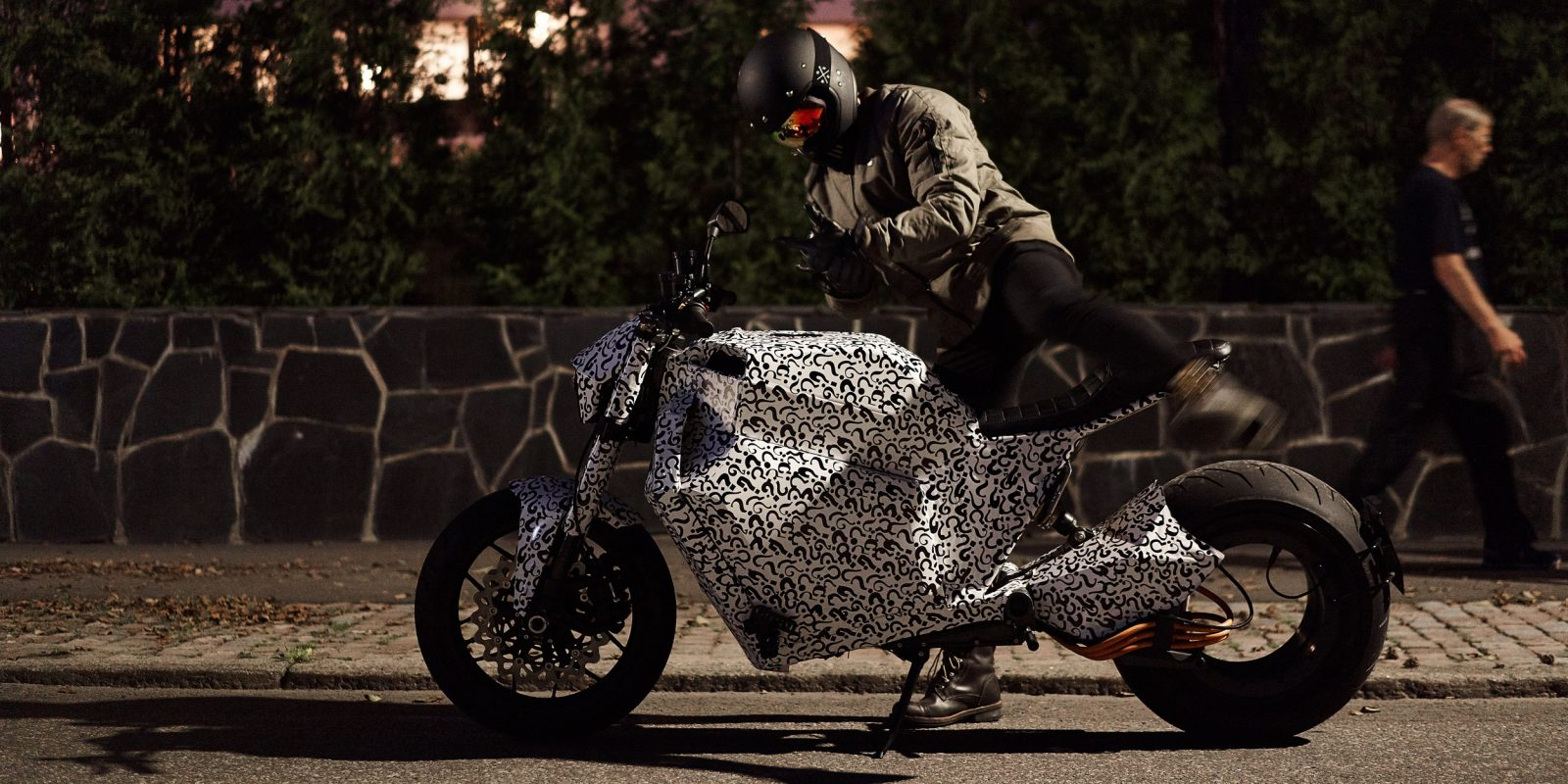 Check out RMK's hubless electric motorcycle seen in camo ahead of release