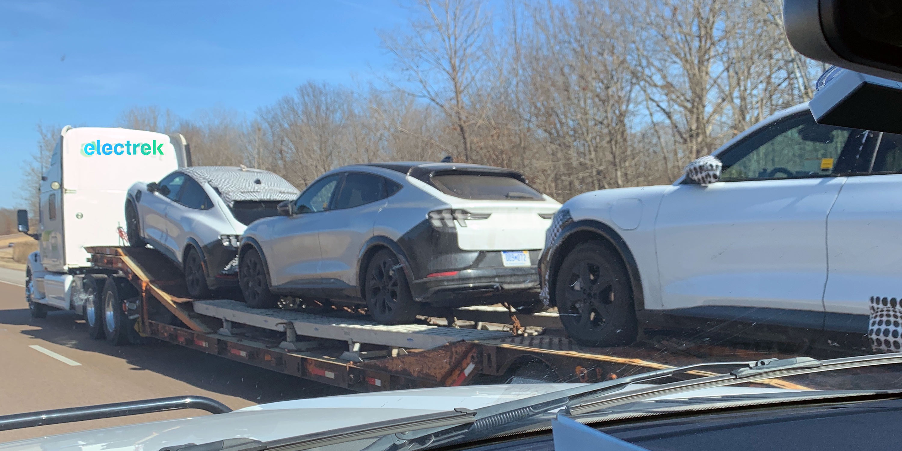 A truck this week hauls three Ford Mustang Mach-E test cars through Missouri and Illinois.