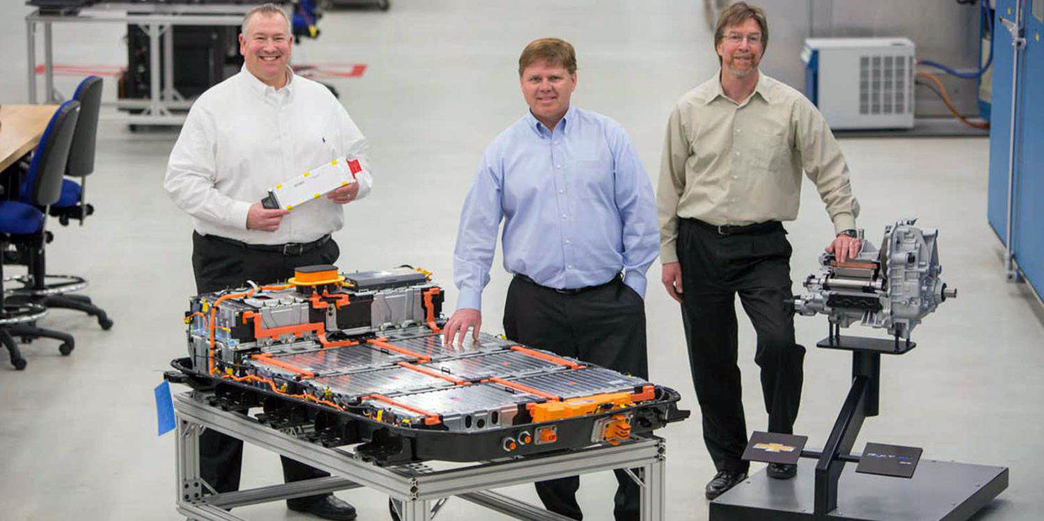 Tim Grewe, center, with colleagues working on the Bolt EV battery pack