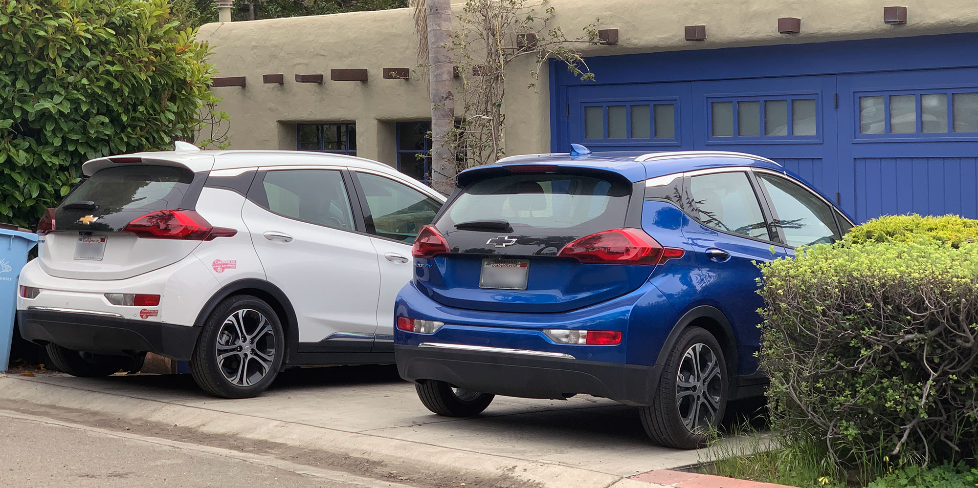 Two Chevy Bolts in the driveway