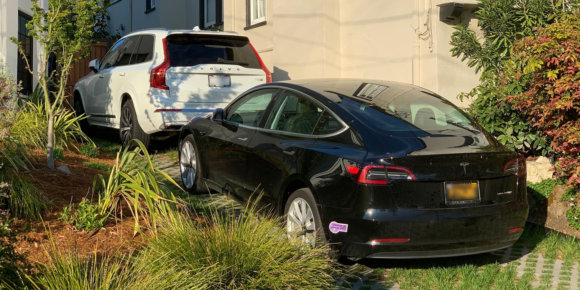 Tesla Model 3 and Volvo Plug-in Hybrid