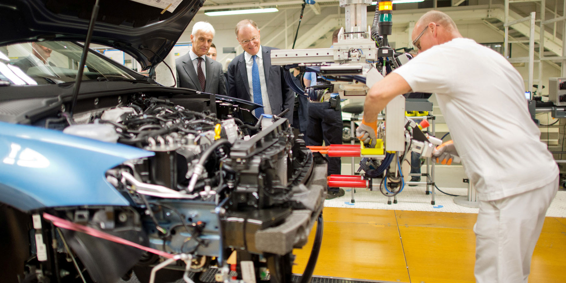 Former VW CEO Matthias Müller (left) and Stephan Weil, premier of Lower Saxony, tour a VW factory in 2017