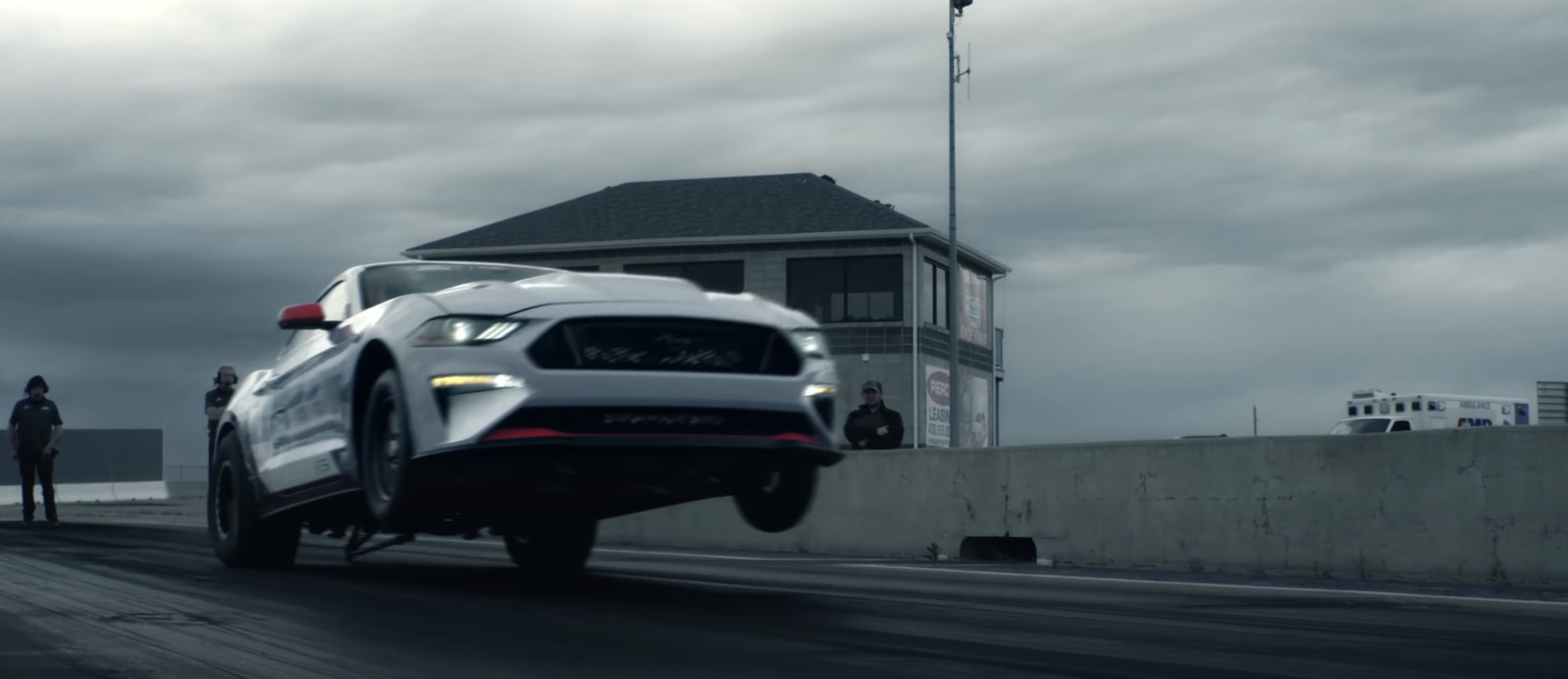 watch ford mustang electric prototype pull a wheelie on the drag strip electrek watch ford mustang electric prototype